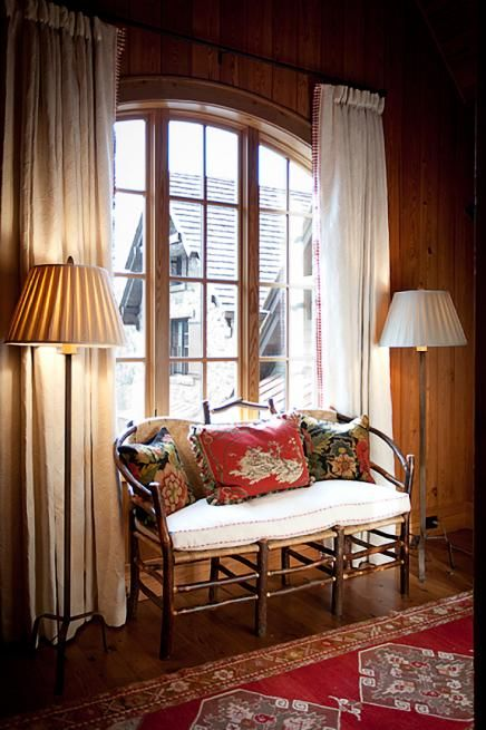 Cream Drapery For Wood Paneled Room And Beautiful Pillows For The