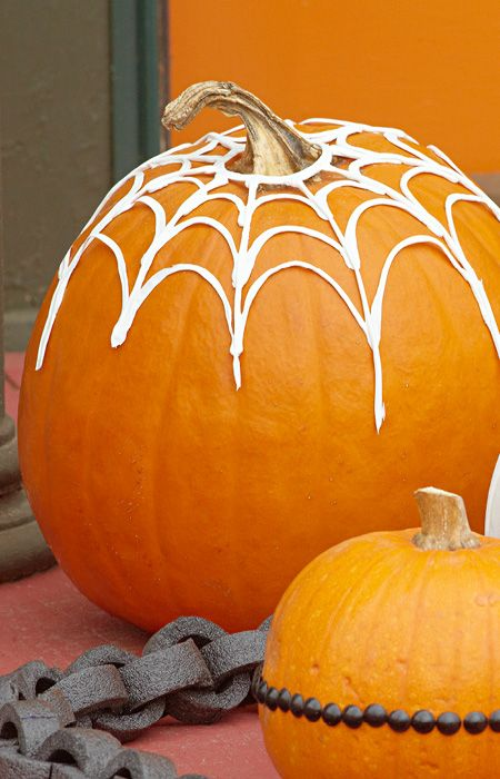caulk makes a spooky spiderweb when draped over a pumpkin or other halloween decorations lowes creative ideaslets do this
