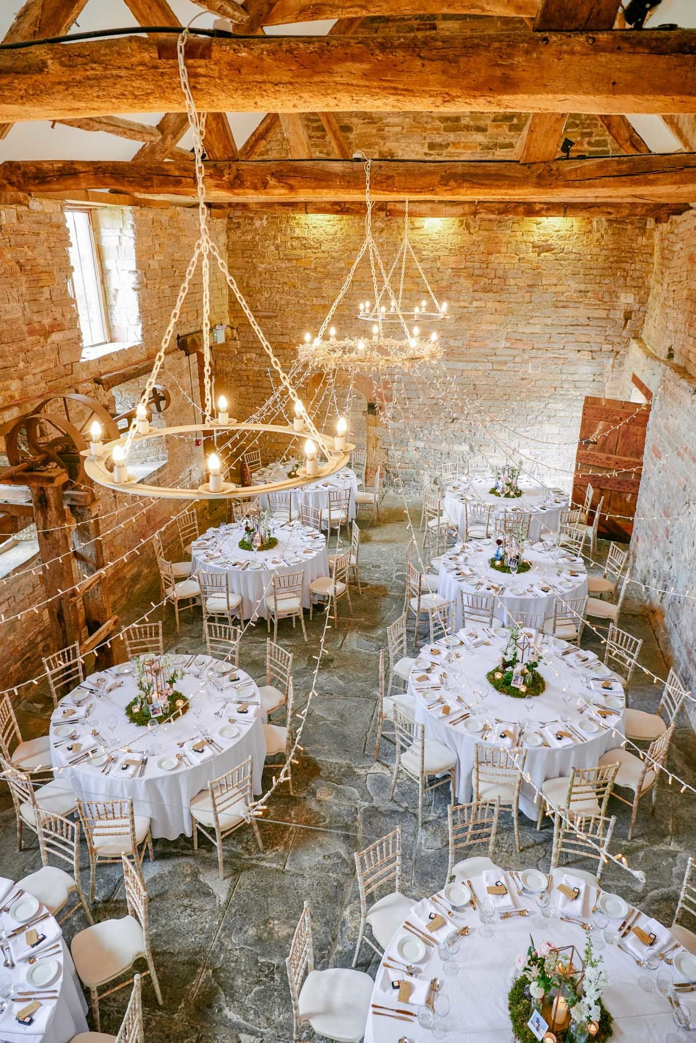 What Stunning Wedding Reception The Almonry Barn In Somerset Is One Of The Oldest Stone B Round Wedding Tables Wedding Venues Somerset Barn Wedding Reception