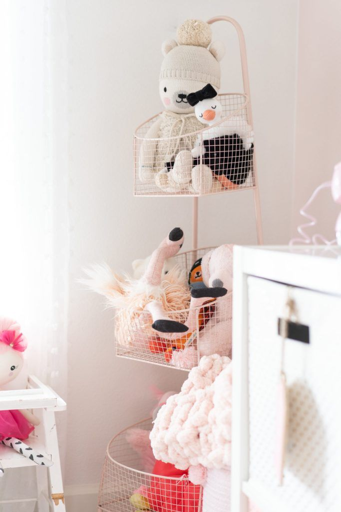 Sharing a full tour of our pink and white striped girls playroom with gold accents on the blog! We've lived in this playroom for almost 4 years now, and have updated quite a bit. We've added a few more storage and organizational pieces to make the room function well for us! #playroom #playroomdecor #pinkandwhitestripes #tassels #childrensdecor #kidsdecor #girlsroomdecor #unicorndecor #pinkandgold #goldaccents #homedecor