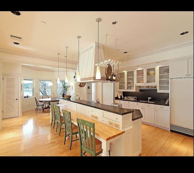 Large Kitchen Island With Storage Above Lower Seating Counter For