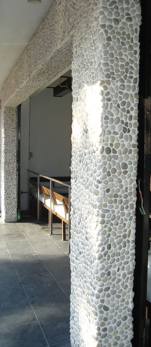 polished white pebble tile archway