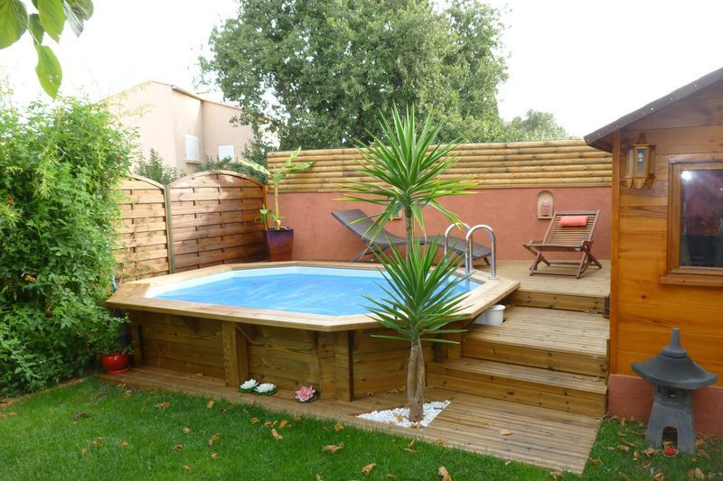 Piscine bois octogonale allong e semi enterr e toulon var - Terrasse piscine semi enterree ...