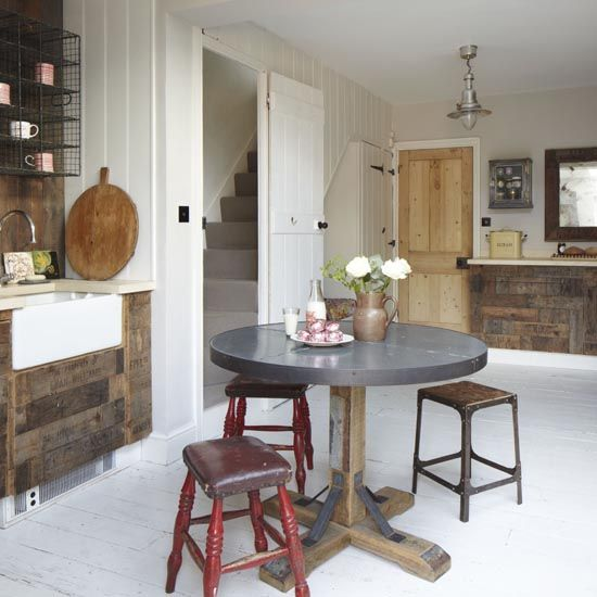 Family kitchen-diner with reclaimed wood units, butler sink and mismatched chairs