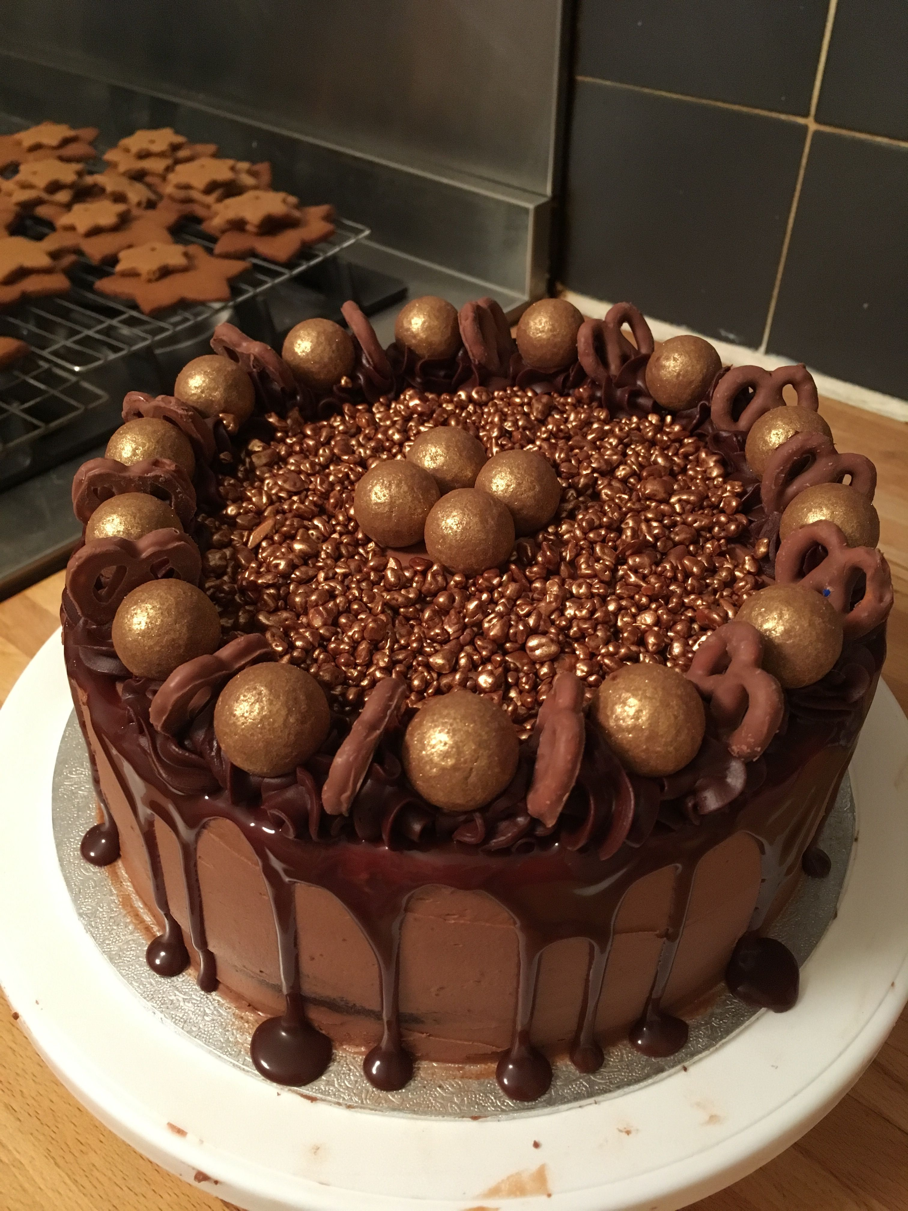 Chocolate Truffle Cake With Buttercream Sauce Honeycomb Covered Pretzels And Caramel Filled Truffles