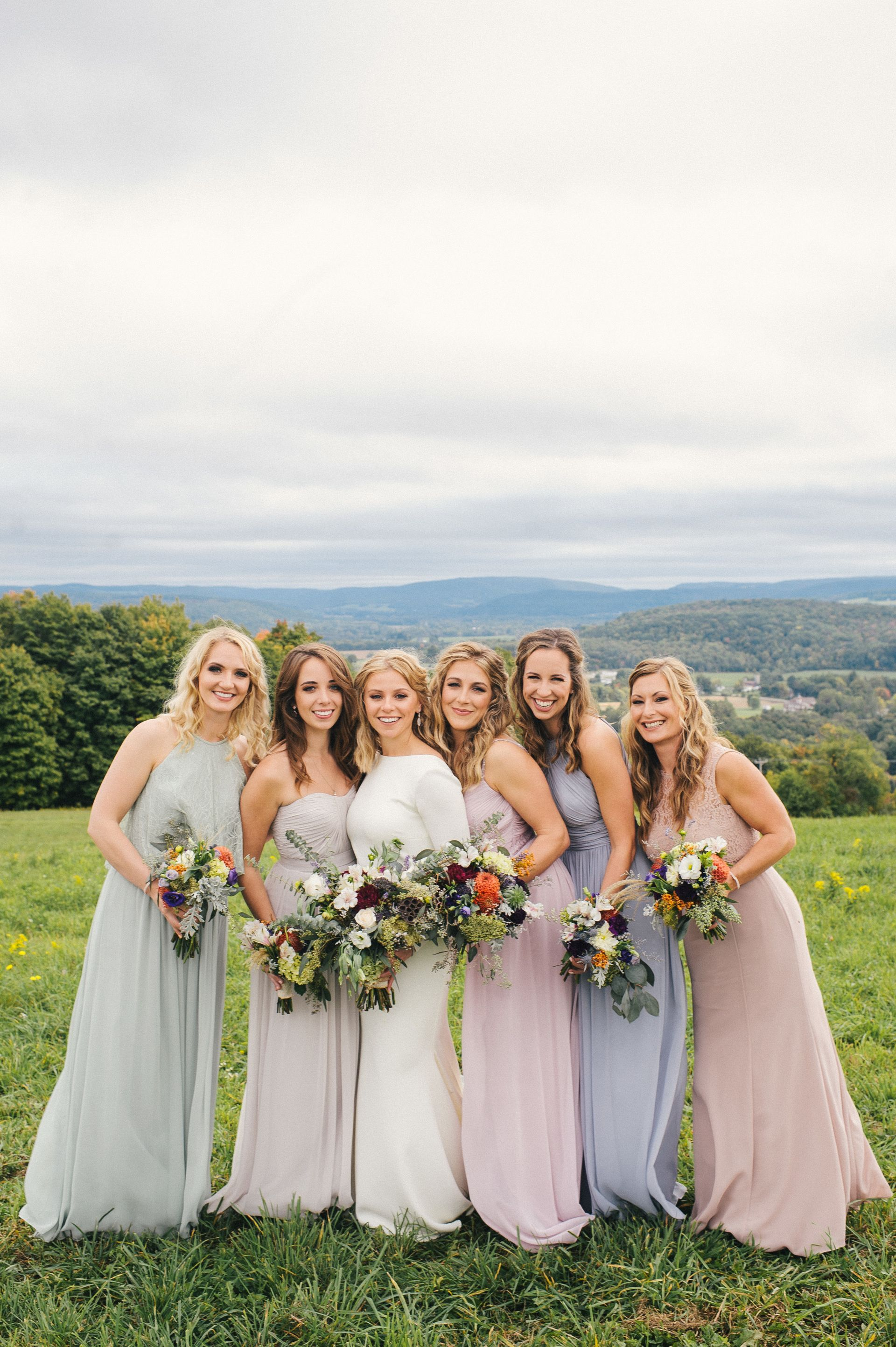 Light pink tan fall wedding at holimont ski resort bridesmaid fashion lavender and seafoam green bridesmaid dresses mismatched styles bouquets of wildflowers ombrellifo Choice Image