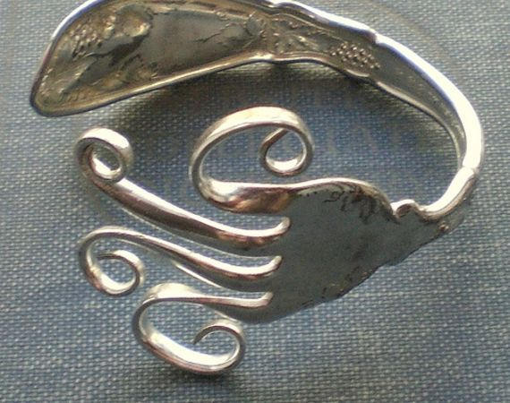 fork Jewelry how to  1. get old fork  2. bend however you like   3. wear it!!!