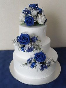 Three silk flower wedding cake toppers in royal blue silver and