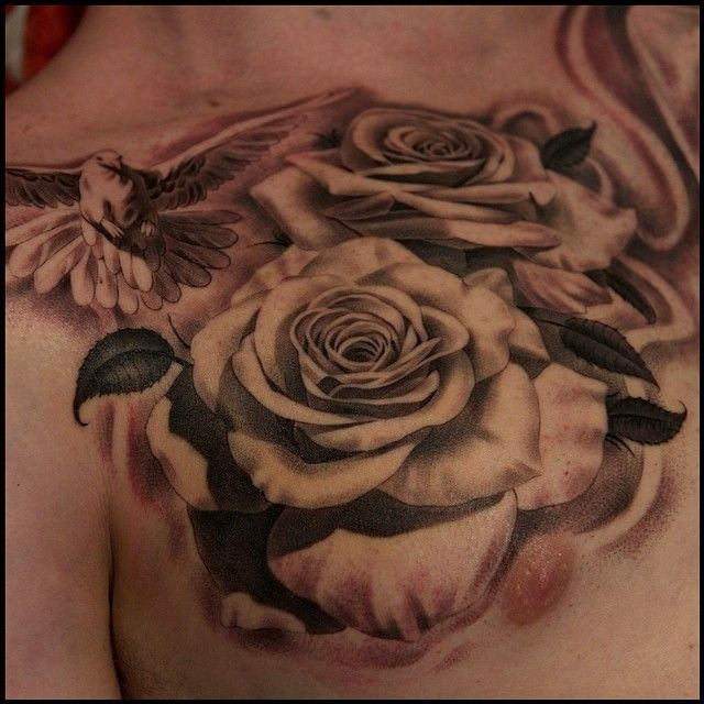 Cool Rose And Dove Chest Tattoo By Noah Minuskin.
