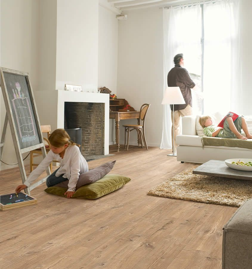 Turn your home or office space into a rustic yet stylish haven with the Quickstep Eligna oak plank saw cuts natural laminate flooring from flooringsupplies.co.uk. Check out the photos above to see how each of the extra wide planks is designed with a truly realistic wood grain to make your home or office look beautiful.