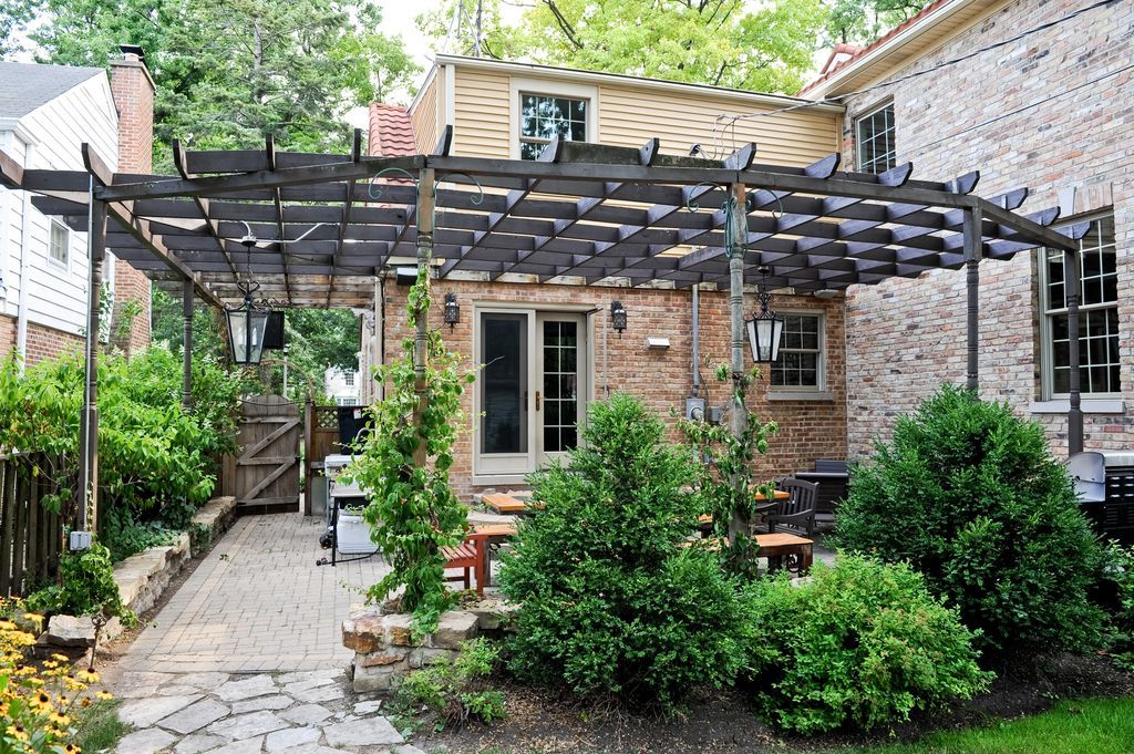 traditional patio with exterior brick floors trellis gate