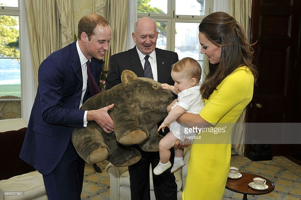 In this handout image supplied by Admiralty House, the official Sydney residence of the Governor-General, Prince George of Cambridge, with his parents Prince William, Duke of Cambridge and Catherine, Duchess of Cambridge, receives a gift from the Governor-General Sir Peter Cosgrove at Admiralty House, on April 16, 2014 in Sydney, Australia. The Duke and Duchess of Cambridge are on a three-week tour of Australia and New Zealand, the first official trip overseas with their son, Prince George…