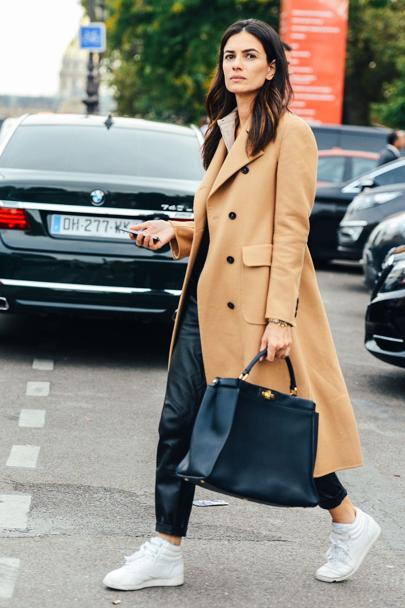 Weekend chic outfit | camel coat | hermes | white sneakers and jogger black jogger pants | rebook high top princess