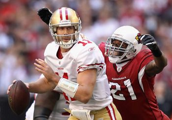 San Francisco 49ers' Alex Smith about to get sacked by the Arizona Cardinals