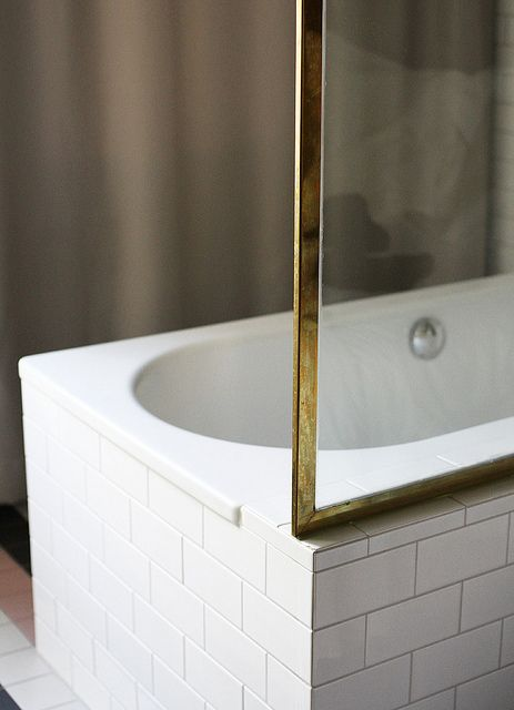 Scandinavia trip by AMM blog, via Flickr - gold and white subway tile