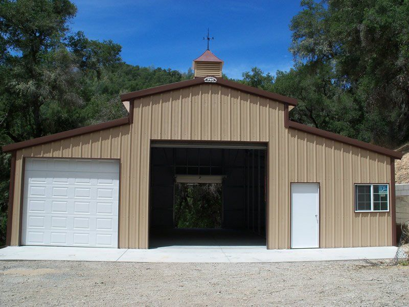 Medium Sized Steel Rv Garage With Separate Storage Area And Office
