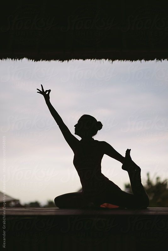 Woman in Pigeon Pose by alexgrabchilev | #Stocksy United #bali #yoga #yogapractice #nature #ubud #healthyliving #lifestyle #relaxation #healing #yogapractice #relax #ubud