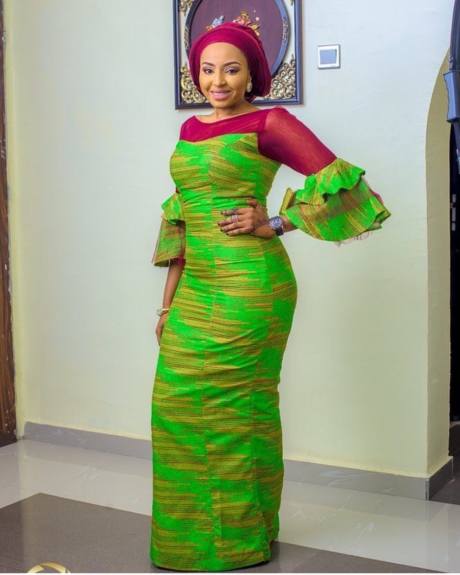 There are a lot of ways to enable oneself be unique with an Ankara fabric, Even if you are thinking of what to make and slay with an aso ebi style. Nigerian Yoruba dress styles for parties arrive in many patterns and designs.   The Ankara designs beauty of this print is that it comes in many designs and textures. Ankara will permit you create a get along with of any cloth without losing the Ankara dress styles flair. #nigeriandressstyles