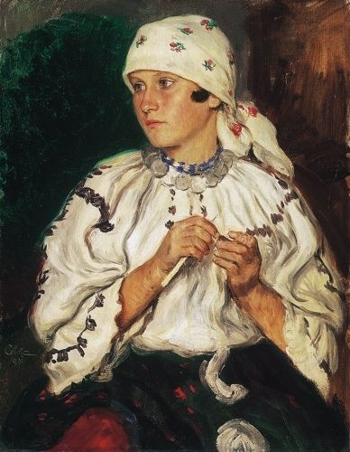 Fiatal lány fehér fejkendővel