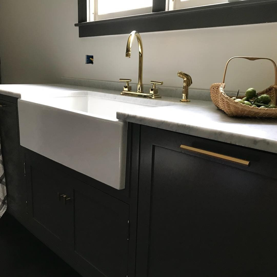 From The Black Cabinets With Brass Pulls To The Farmhouse Sink With Brass Fixtures This Kitchen Just Screa White Farmhouse Sink Farmhouse Sink White Farmhouse