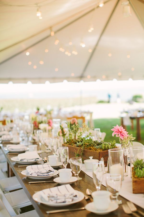 gorgeous tented reception, photo by Rebecca Arthurs http://ruffledblog.com/rhode-island-beach-wedding #weddingreception #tents #tablescapes