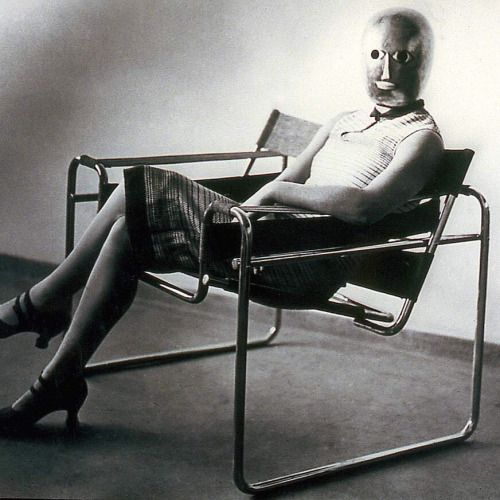 bauhaus-movement:  Lis Beyer or Ise Gropius sitting on the B3 club chair by Marcel Breuer and wearing a mask by Oskar Schlemmer and dress fabric by Beyer, c.1927. Herzogenrath, Berlin. © Estate Erich Consemüller