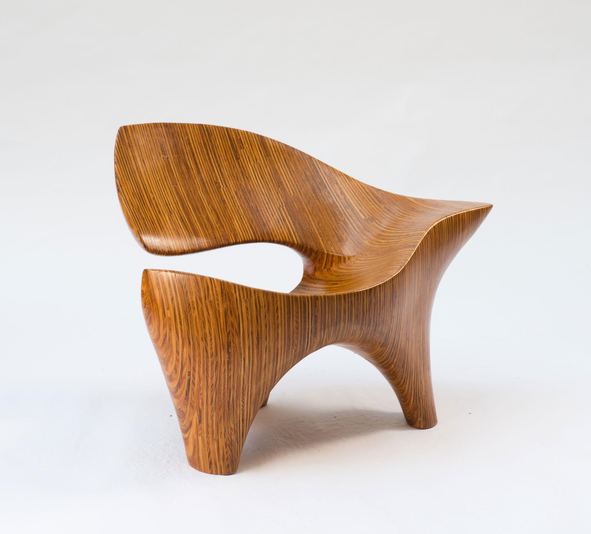 Irregular contoured shape posed of thin layers of plywood