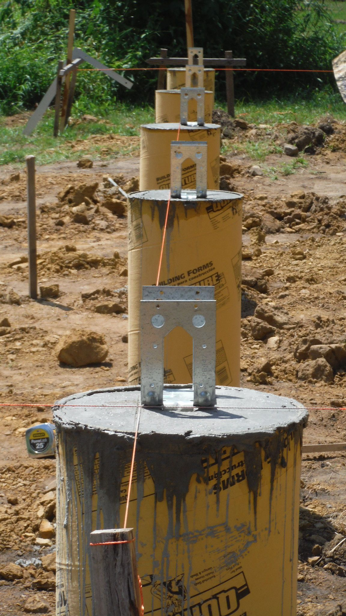 After the pour we set our girt anchors to plum aligned for Cabin foundation piers