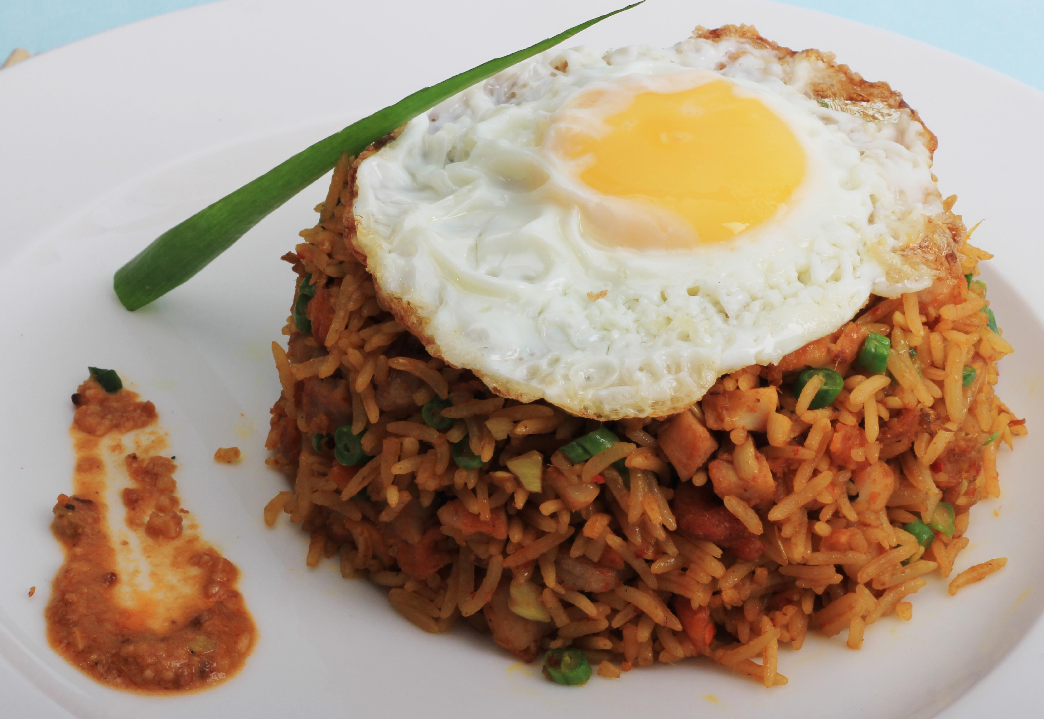 #Nasi #Goreng - #Indonesian style fried #rice with #chicken &shrimps, in an aromatic #chilli paste