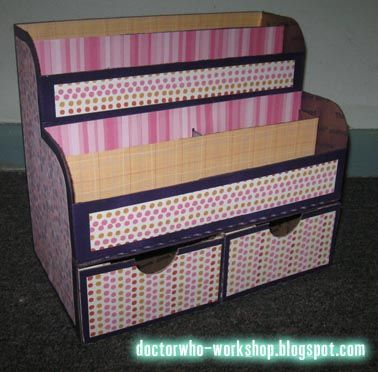 """DIY Desk Organizer - here's the """"after"""".  She used the USPS shipping boxes and covered them."""