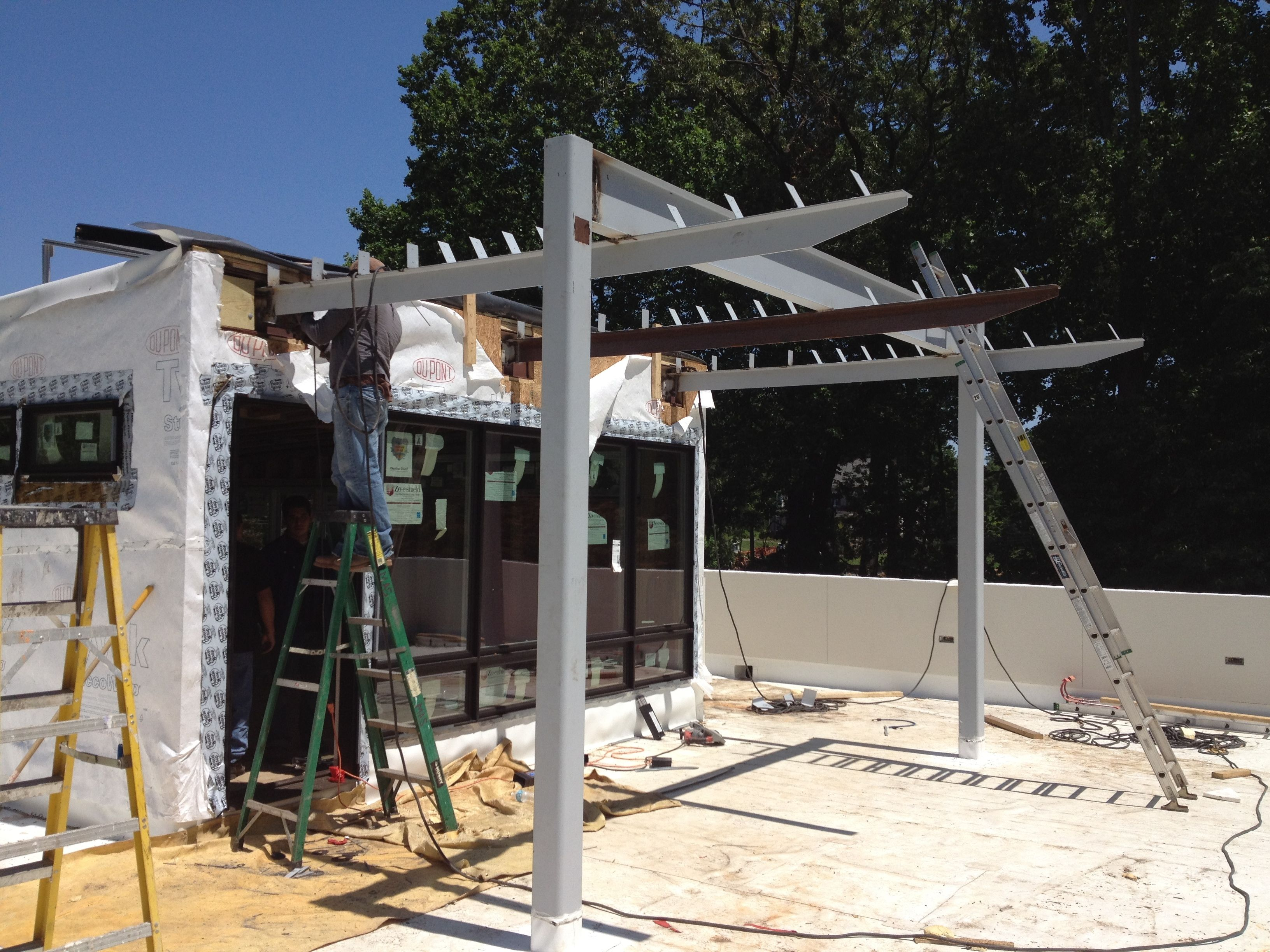 Installing a steel sun shade structure open pergola for Sun shade structure
