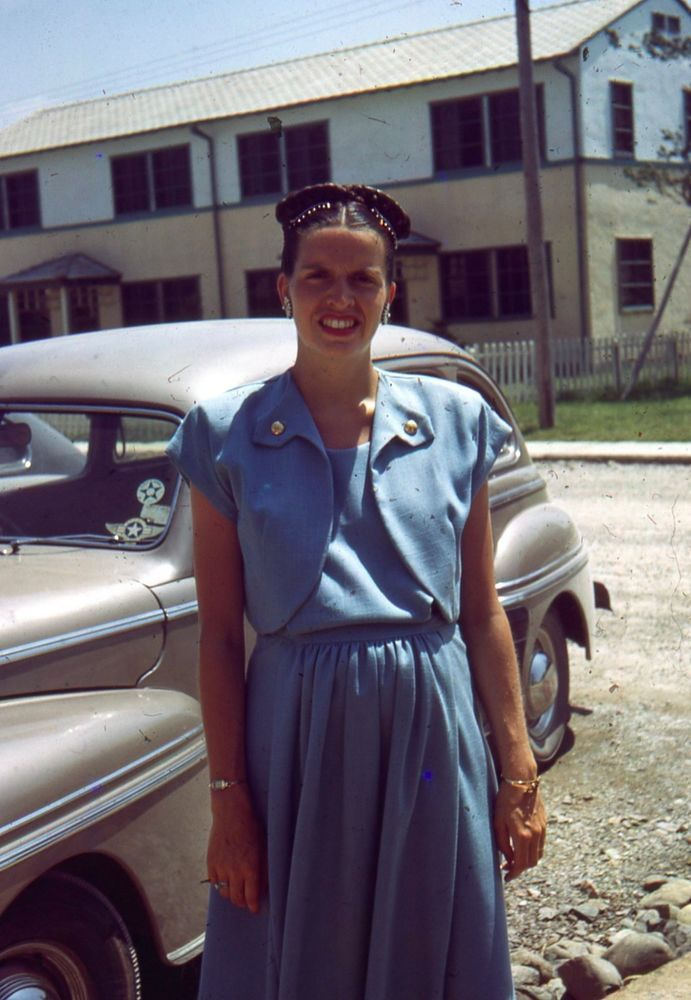 1940s Red Border Woman In A Suit Standing By A Car
