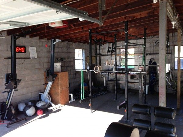His and her garage gym double rower squat