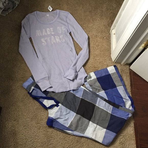 Old navy pajama set Has tags , colors blue ; light purple & white & gray , only flaw has a mark as shown in the picture should come off if you wash top is an xs bottoms are a small Old Navy Intimates & Sleepwear Pajamas
