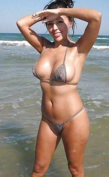 Brunette milf on the beach