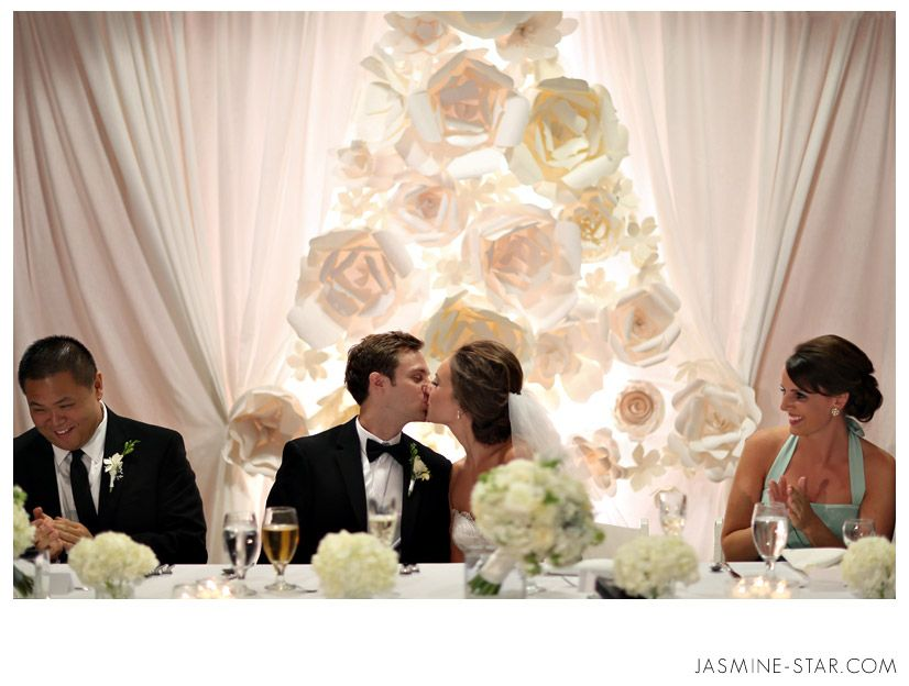 Love The Draping And Paper Flowers Behind The Head Table Another Photo Showed The Fabric Looked Like I Wedding Decorations Wedding Backdrop Reception Backdrop