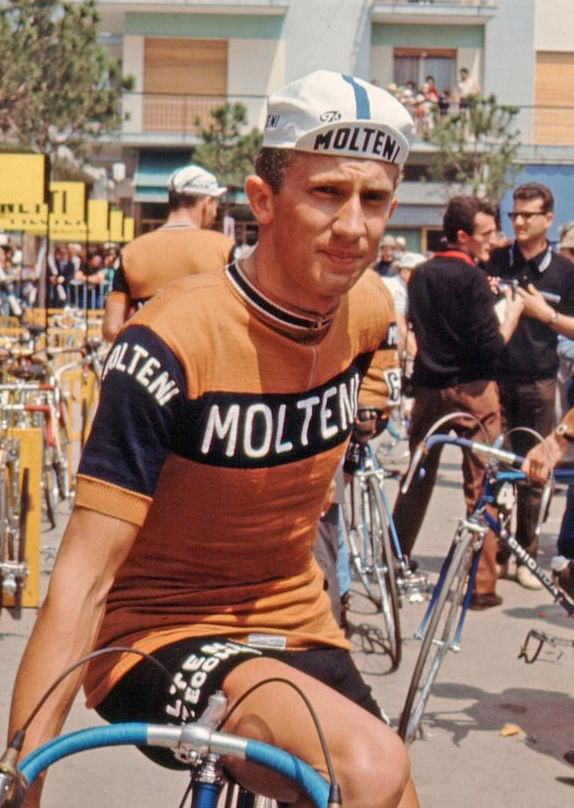 Gianni Motta sitting on the crossbar of his bicycle at the start of a stage  of the Giro d Italia. 916548290