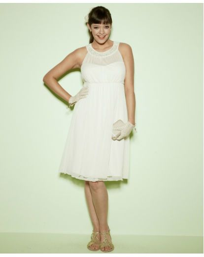 Wedding dress available in sizes 12-32  Cream dress with pearl trim.