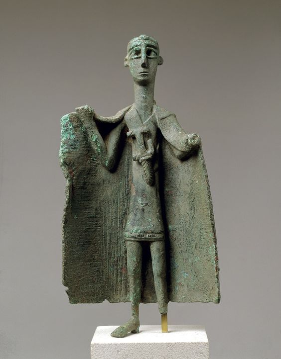 Sardinian bronze Capotribu, Chief of the herdsmen, 10th-7th century B.C. Such Capitribu have been variously interpreted as being the representations of a Nuragic prince, a shepherd-king, a tribal chieftain, or simply as chief of the herdsmen, which we prefer. Sardinian society at the time was aristocratic and feudal. We ignore the distinction between the local prince and the local religious leader, 24.5 cm high. George Ortiz collection
