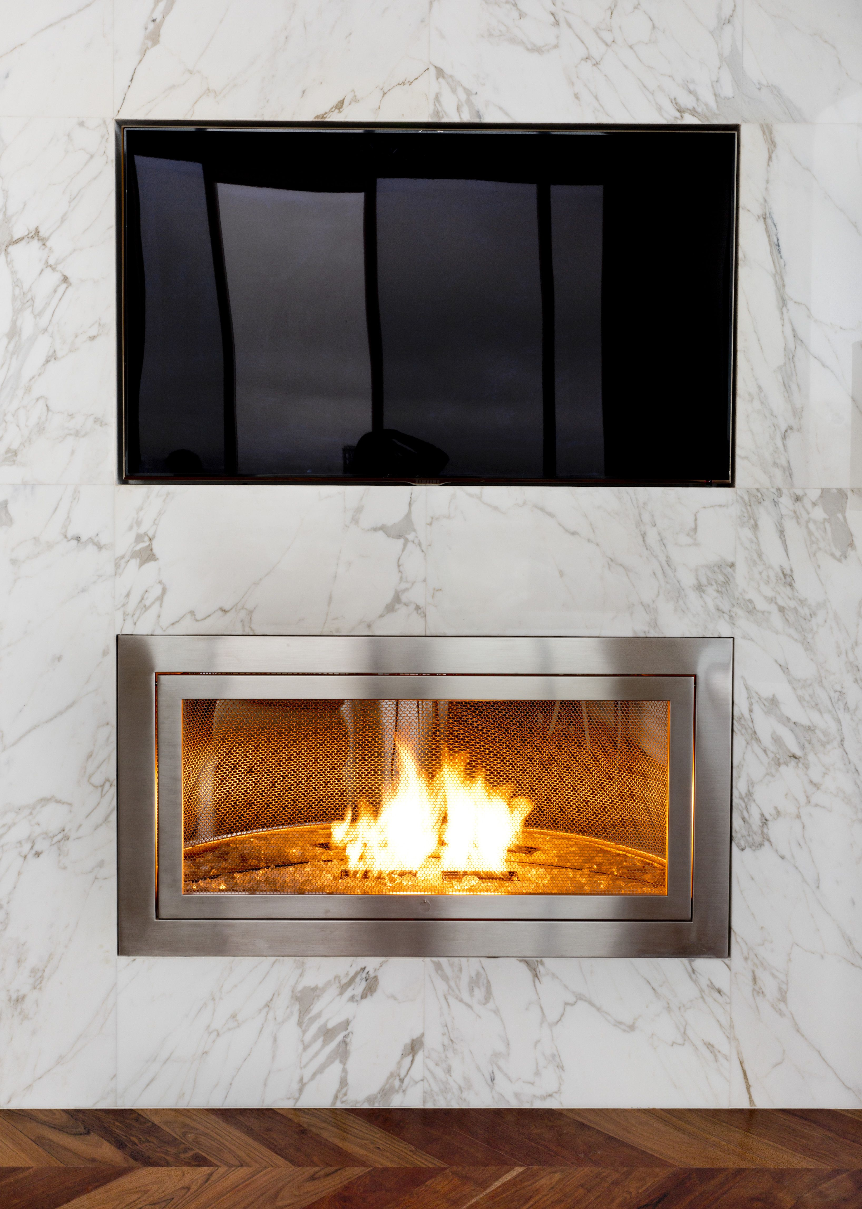 From The Marble Surround To The Stainless Steel Fireplace This