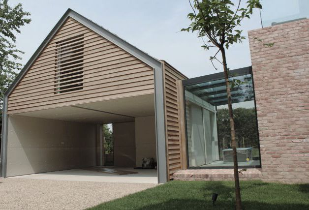 A Sensitive Modern Extension And Timber Clad Car Barn To Complement Century House Within Special Conservation Area