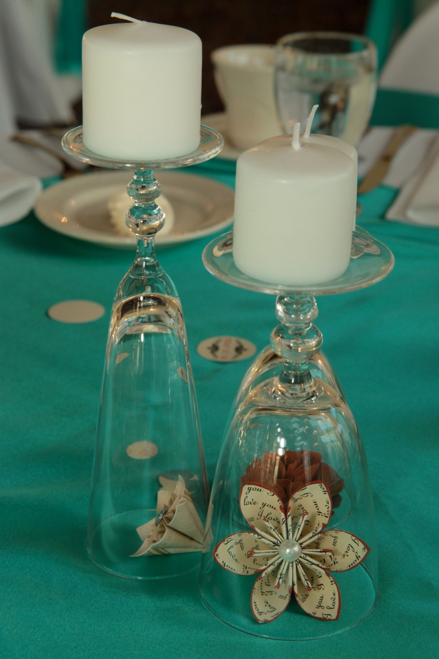 Upside down wine glasses candles and paper flowers diy