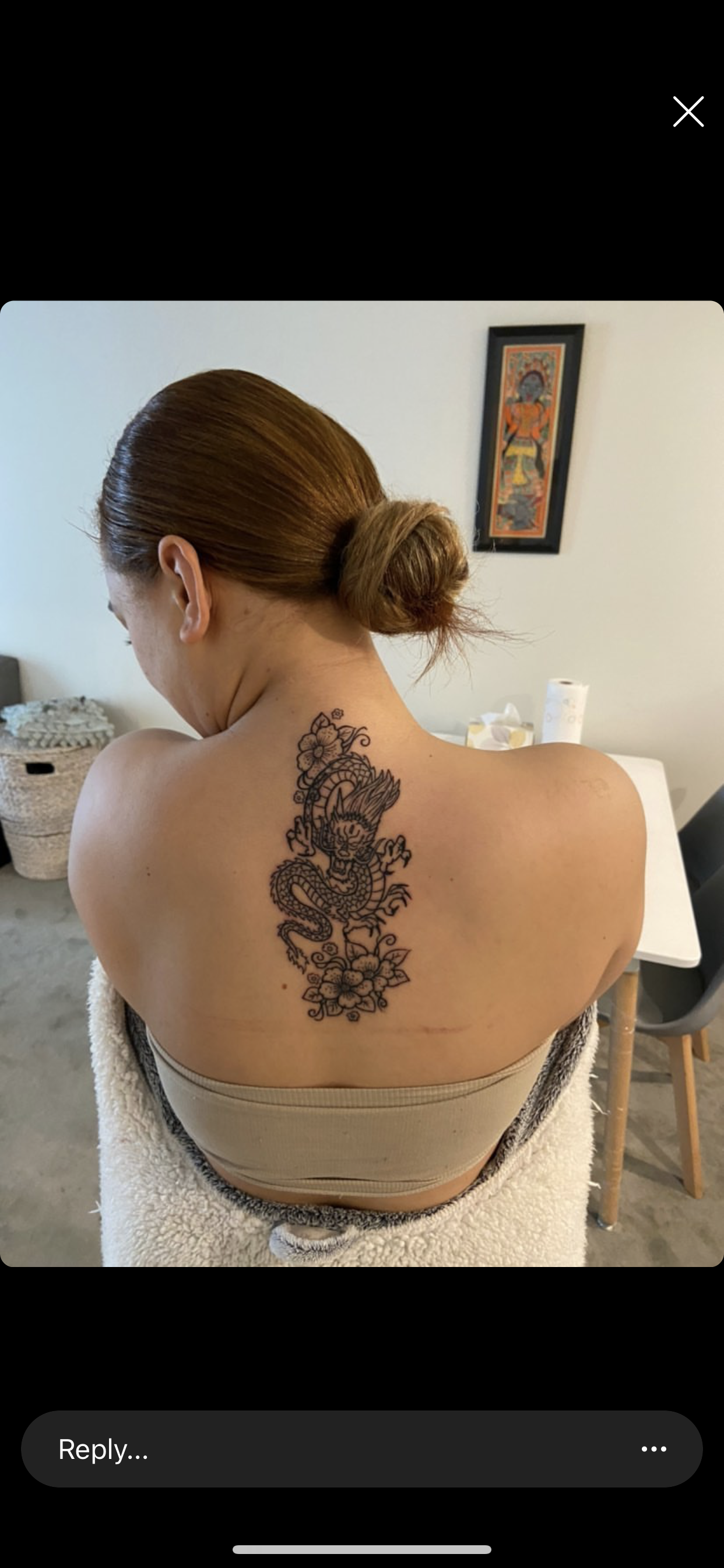 Photo of Traditional Chinese dragon with anemone type flowers tattoo