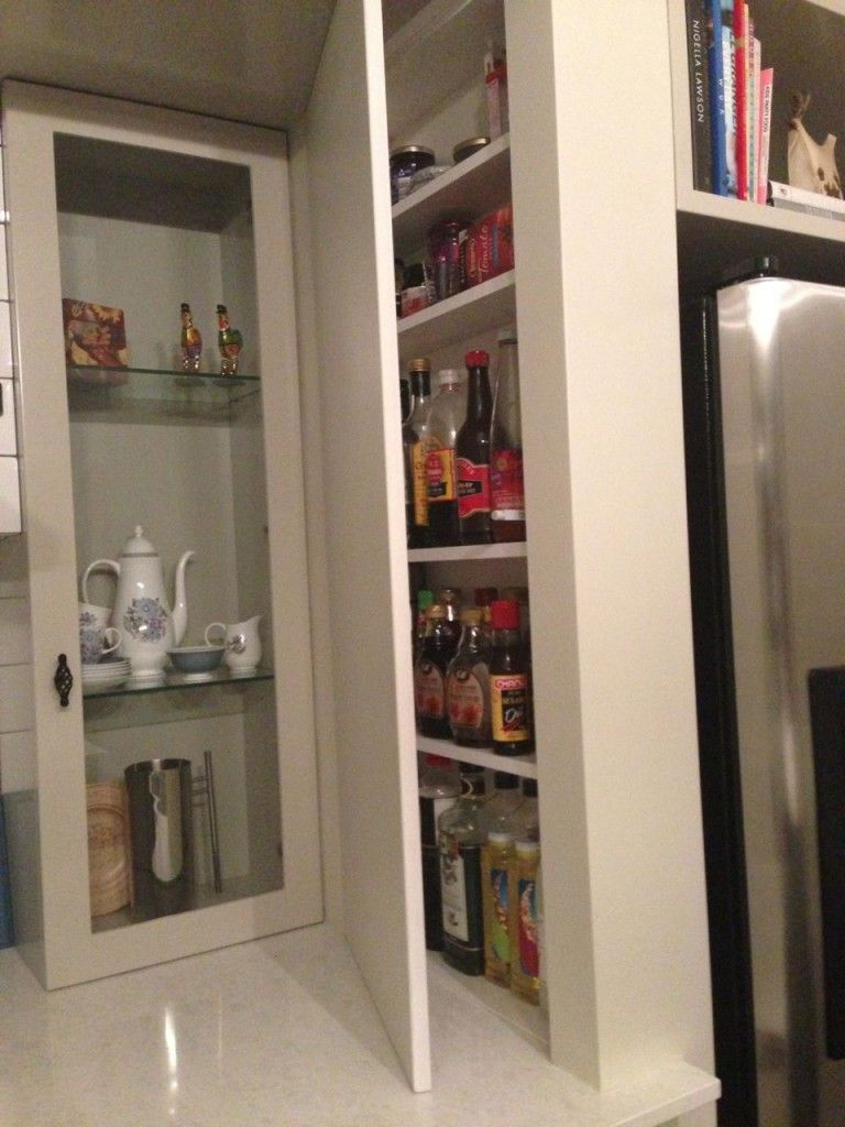 Sauce and oil bottle cupboard in the kitchen home is where you are