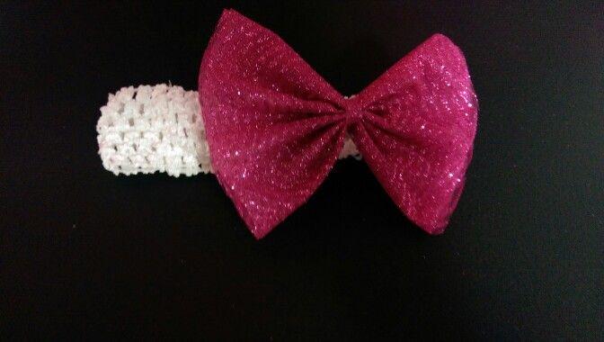 Crochet headband with pink bow