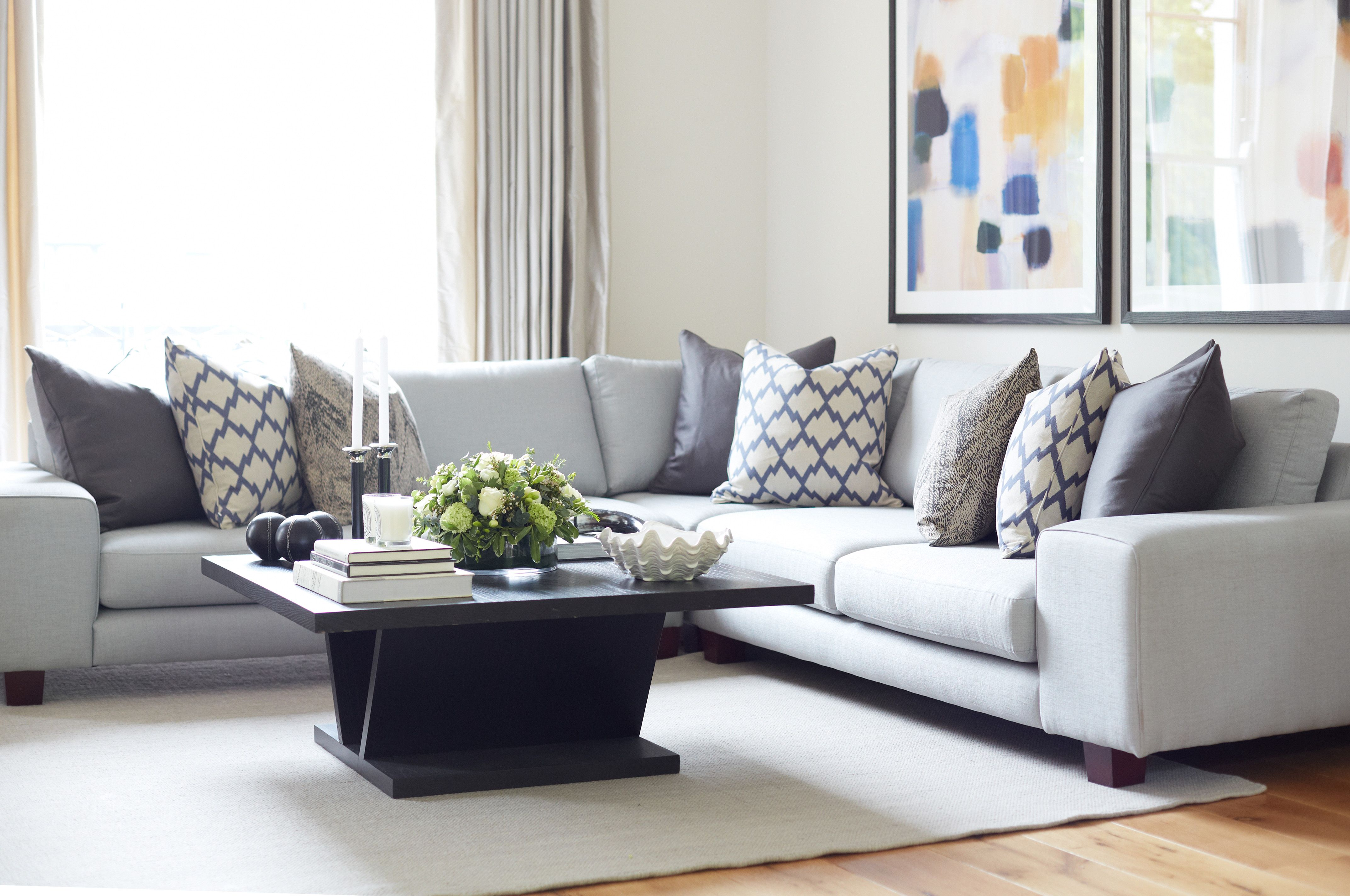 We Used This Light Grey Corner Sofa To Create A Relaxed Feeling In The Reception Room Of This G Sofa Cushions Arrangement Corner Sofa Cushions Cushions On Sofa