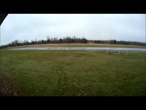 Glider with pontoons on grass.