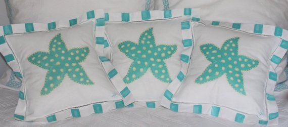Turquoise Starfish Linen Coastal Pillow is part of Coastal decor Mantle - This turquoise starfish linen pillow comes with your choice or personalization or you can order it plain as pictured  Great with a family name or name of your favorite beach  This  linen pillow measures 12 x 12  and would look great in the guest room, nursery or any beachy room  Pillow form is removable and cover is hand washable  Iron on reverse   Stripes are hand painted  For decorative use only Artist retains all reproduction rights and copyrights Listing items, images, and content ©2014 Lemondaisy Design FOR PERSONAL USE ONLY  NOT TO BE RESOLD