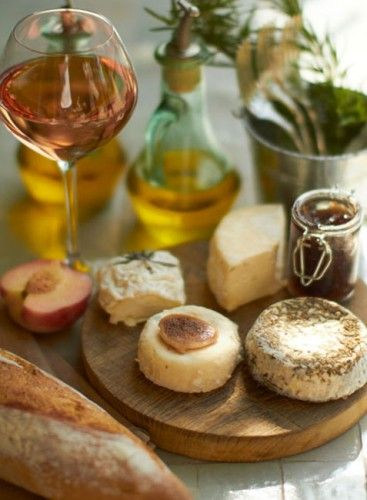 Rose wine, baguette and cheese