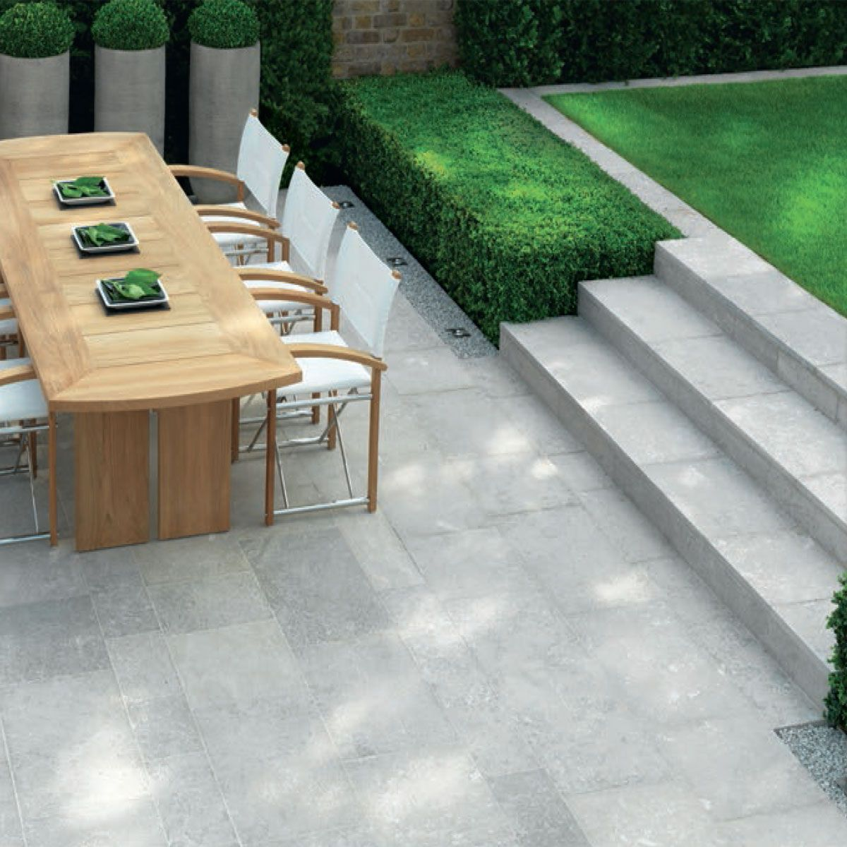 Single white paving slabs back garden pinterest for Garden decking and slabs